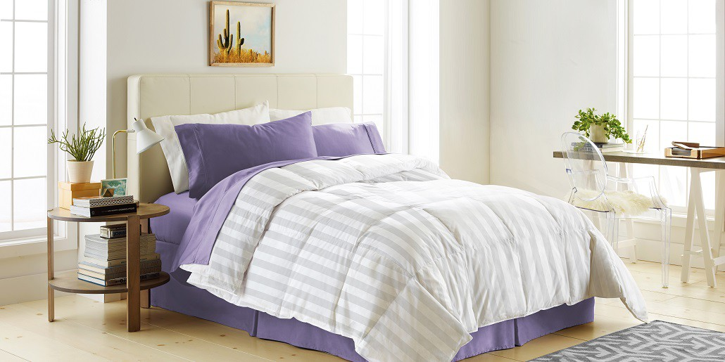 bed with comforter.