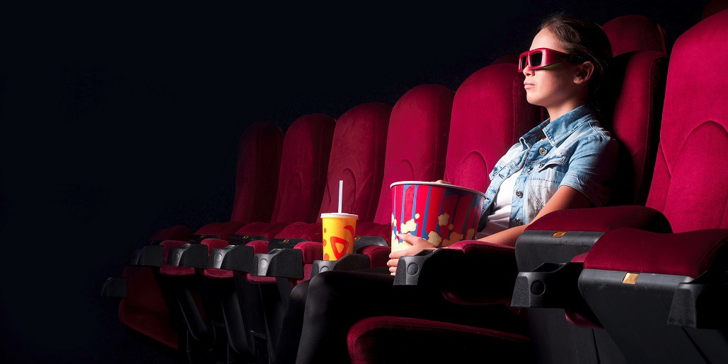 girl in movie theater with 3d glasses