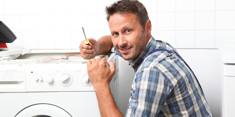 repair man with broken appliance.