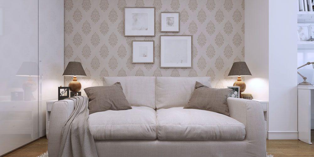 wall art hanging above white sofa.