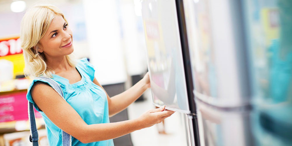 woman shopping for refrigerator